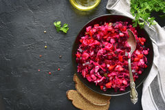 Traditional russian beetroot salad vinaigrette on a dark plate . royalty free stock photography