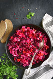 Traditional russian beetroot salad vinaigrette on a dark plate . Royalty Free Stock Photos