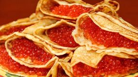 Traditional Russian blini pancakes with red caviar. Pancake week. Maslenitsa is an Eastern Slavic traditional holiday royalty free stock photo