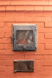 Traditional russian brick oven. Russian brick oven with fire close up Royalty Free Stock Photo