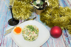 Traditional Russian christmas salad Olivier. With sausage and fresh cucumbers Stock Photography
