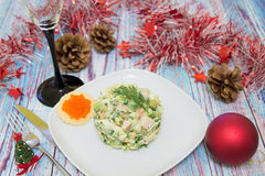 Traditional Russian christmas salad Olivier. With sausage and fresh cucumbers Royalty Free Stock Photo