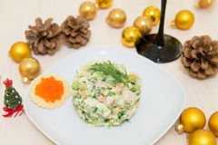 Traditional Russian christmas salad Olivier. With sausage and fresh cucumbers Stock Images