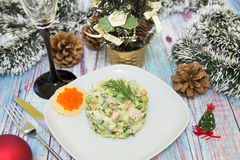 Traditional Russian christmas salad Olivier. With sausage and fresh cucumbers Stock Image
