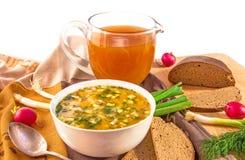 Traditional russian cold soup okroshka, jug with kvass and bread. Traditional russian summer cold kvass soup okroshka in a white ceramic bowl, jug with kvass ( Stock Photo