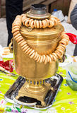 Traditional Russian copper samovar for tea drinking with bagels Royalty Free Stock Images
