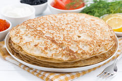 Traditional Russian crepes on plate Stock Photos