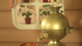 Traditional russian desserts and samovar props on table stock video footage
