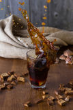 Traditional Russian drink kvass from bread, rye malt, sugar and water. Kvass in a glass on a dark wooden background. Splash stock photography