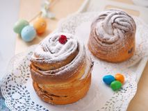 Traditional Russian easter cake. Cruffin dessert, decorated with sugar powder, cranberries and easter eggs. Homemade treat. Stock Photography