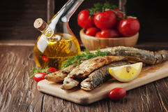 Traditional russian fish smelt on the wooden table Stock Photography