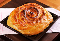 Traditional Russian homemade pie. Fresh-baked in oven. Shallow DOF Royalty Free Stock Photography