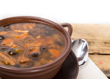 Traditional Russian meat soup with salty cucumbers Royalty Free Stock Photography