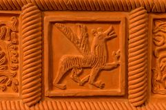 Traditional russian ornament on clay oven tiles.  royalty free stock photography
