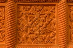 Traditional russian ornament on clay oven tiles.  royalty free stock images