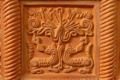 Traditional russian ornament on clay oven tiles.  stock photography