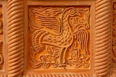 Traditional russian ornament on clay oven tiles.  stock images