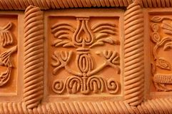 Traditional russian ornament on clay oven tiles.  royalty free stock image