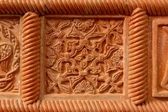 Traditional russian ornament on clay oven tiles.  stock photos