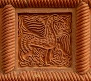 Traditional russian ornament on clay oven tiles.  royalty free stock photo