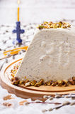 Traditional Russian Orthodox Easter Desserts. Easter , a Traditional Russian Orthodox Easter Desserts, cottage cheese and cream with pistachios. Decorated with stock image