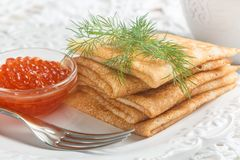 Traditional Russian pancakes blini  with salmon caviar Royalty Free Stock Image