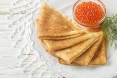 Traditional Russian pancakes blini  with salmon caviar Stock Image