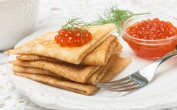 Traditional Russian pancakes blini  with salmon caviar Royalty Free Stock Photos