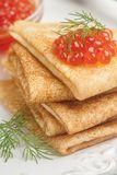 Traditional Russian pancakes blini with salmon caviar. On a white plate. Selective focus stock photo