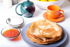 Traditional Russian pancakes with caviar and sour cream. Shrovetide Royalty Free Stock Image