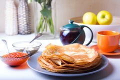 Traditional Russian pancakes with caviar and sour cream. Shrovetide Stock Photo