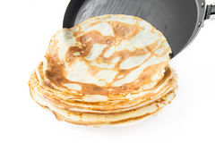 Pancakes from the frying pan on plate Royalty Free Stock Photos