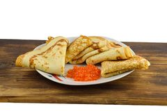 Traditional Russian pancakes with red caviar. Royalty Free Stock Images