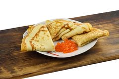 Traditional Russian pancakes with red caviar. Stock Image