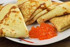 Traditional Russian pancakes with red caviar. Stock Images