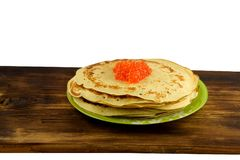 Traditional Russian pancakes with red caviar. Some pancakes with caviar on the plate and wooden board on white background Stock Photos