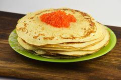 Traditional Russian pancakes with red caviar Stock Photo