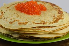 Traditional Russian pancakes with red caviar Royalty Free Stock Photo