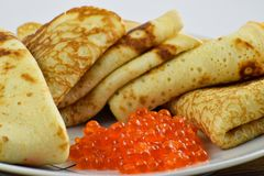 Traditional Russian pancakes with red caviar. Stock Photo