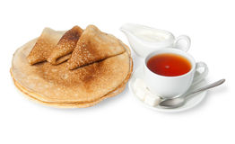 Traditional russian pancakes with sour cream and tea Stock Photography