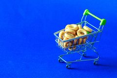 Traditional Russian product of drying with poppy in a cart from the supermarket. Some did not enter fell next to the cart Royalty Free Stock Photos