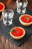 Traditional russian red caviare on the wooden table. Selective focus Royalty Free Stock Photos