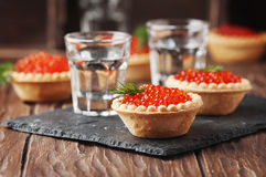 Traditional russian red caviare on the wooden table. Selective focus Stock Photo