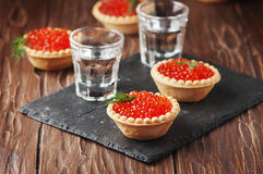 Traditional russian red caviare on the wooden table Royalty Free Stock Images