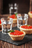 Traditional russian red caviare on the wooden table Stock Photo