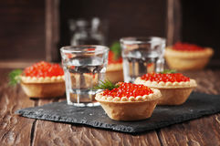 Traditional russian red caviare on the wooden table Royalty Free Stock Photos