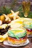 Traditional Russian salad - herring under a fur coat in bowls Stock Photography