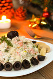 Traditional Russian salad on New Year night - vegetarian version with mushrooms Stock Images