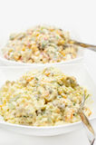 Traditional russian salad olivier on white Stock Photo