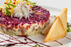 Traditional russian salad. With salted herring and beet root isolated on white background Stock Image